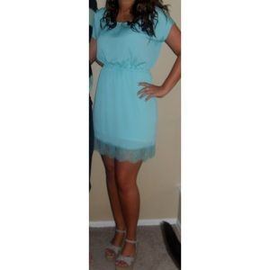 Mint-colored dress with lace trim